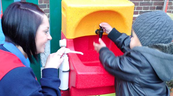 Early Learners enjoy learning hand washing skills