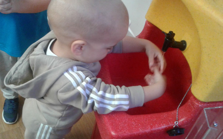 Children learning to wash hands at Honeypot Nursery